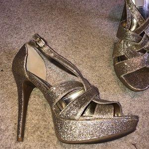 Gold sparkling heels